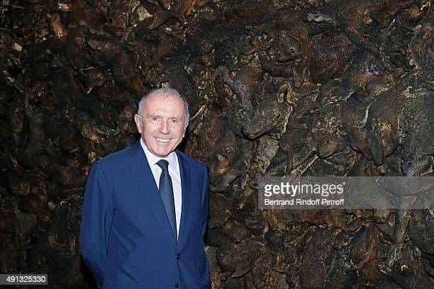 Francois Pinault poses in front of Artist Adel Abdessemed's Work during the 'Picasso Mania' : Press Preview. Held at Grand Palais on October 4, 2015...