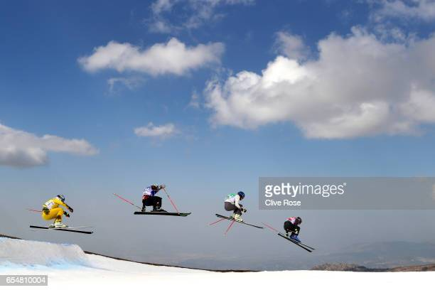 Francois Place of France leads Jamie Pebble of New Zealand Paul Eckert of Germany and Kevin Drury of Canada during the Men's Ski Cross Finals on day...