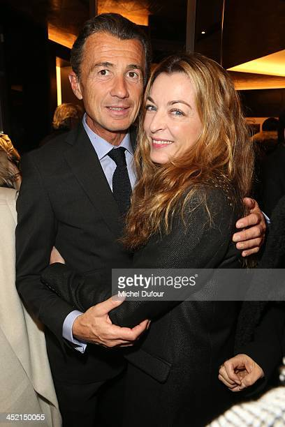 Francois Sarkozy and Arabelle Reill Madhavi attend the Berluti Flagship Store Opening on November 26 2013 in Paris France
