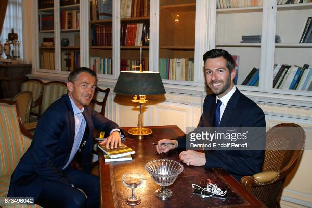 Francois Sarkozy and Christos Markogiannakis attend the presentation of the Book 'Scenes De Crime au Louvre' written by Christos Markogiannakis at...