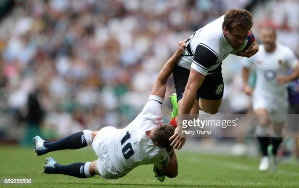 Francois Steyn of Barbarians is tackled by George Ford of England during the Old Mutual Wealth Cup match between England Rugby and the Barbarians at...