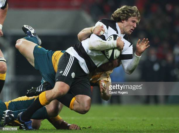 Francois Steyn of The Barbarians is hauled down by the Australian defence during the 1908 2008 London Olympic Centenary match between The Barbarians...