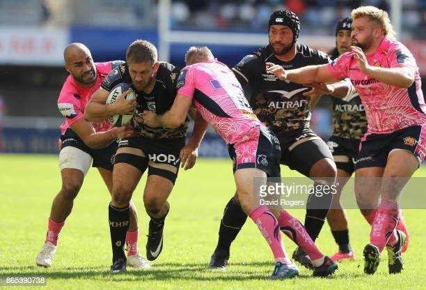 Francois Steyne of Montpellier is tackled by Olly Woodburn