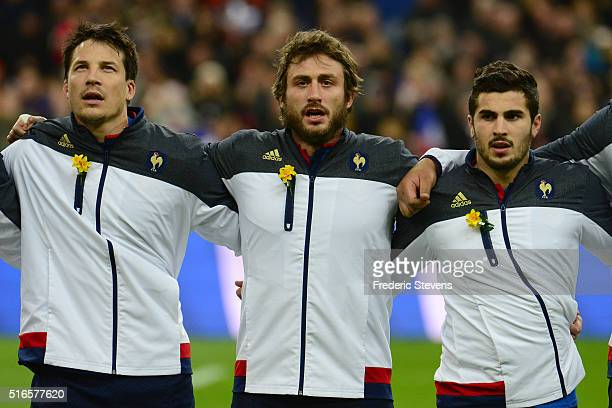Francois TrinhDuc Maxime Medard and Sebastien Bezy the France team line up for the national anthem prior to kickoff during the RBS Six Nations match...