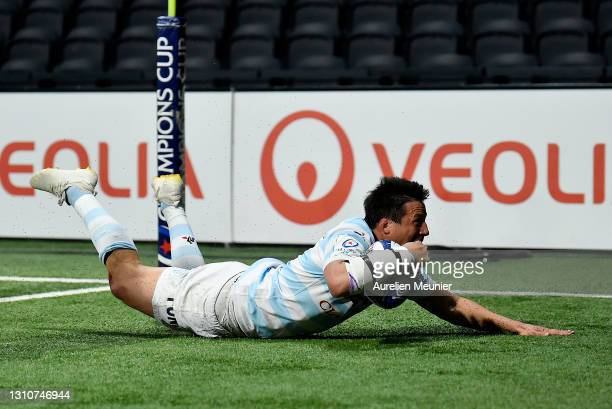 Francois Trinh-Duc of Racing 92 touches down for his team's seventh try during the Round of 16 Champions Cup match between Racing 92 and Edinburgh...