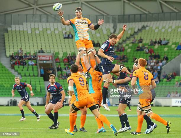Francois Uys of the Cheeters throws the ball away from Scott Higginbotham of the Rebels during the round three Super Rugby match between the...