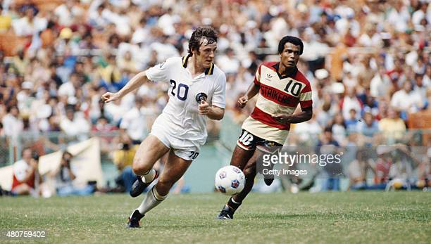 Francois Van der Elst of the New York Cosmos in action as Teofilo Cubillas looks on during the 1980 Soccer Bowl NASL match against Fort Lauderdale...