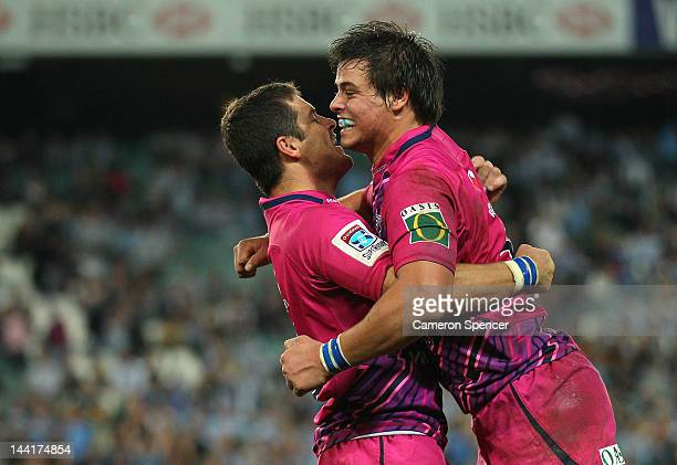 Francois Venter and Morne Steyn of the Bulls celebrate winning the round 12 Super Rugby match between the Waratahs and the Bulls at Allianz Stadium...