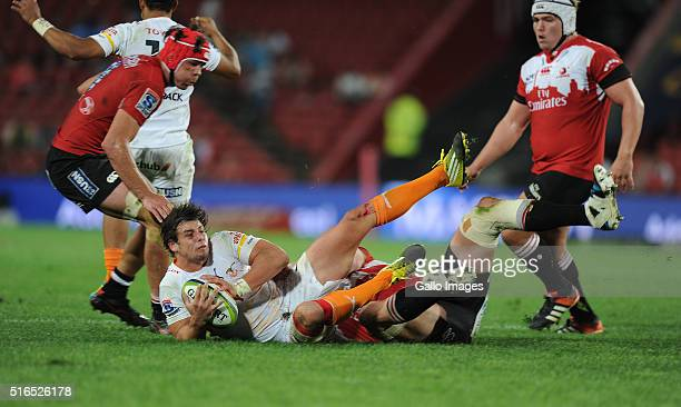 Francois Venter of Cheetahs is tackled by Andries Ferreira of Lions during the Super Rugby match between Emirates Lions and Toyota Cheetahs at...