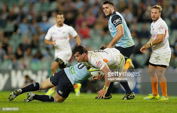 Francois Venter of the Cheetahs is tackled by Bernard Foley of the Waratahs during the round 11 Super Rugby match between the Waratahs and the...