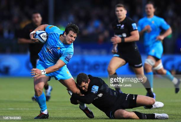 Francois Venter of Worcester Warriors is caught by Alex Goode of Saracens during the Gallagher Premiership Rugby match between Saracens and Worcester...