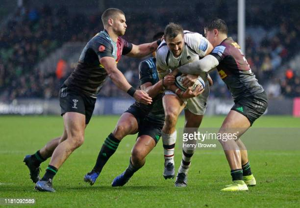 Francois Venter of Worcester Warriors is tackled by James Lang Marcus Smith and Cadan Murley of Harlequins during the Gallagher Premiership Rugby...