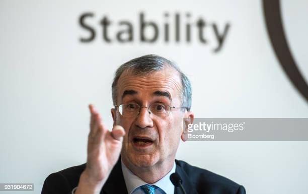 Francois Villeroy de Galhau governor of the Bank of France gestures while speaking at the 'ECB and its Watchers' conference in Frankfurt Germany on...