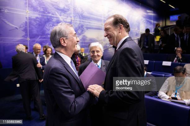 Francois Villeroy de Galhau governor of the Bank of France left speaks to David Malpass president of the World Bank Group during the 75th anniversary...