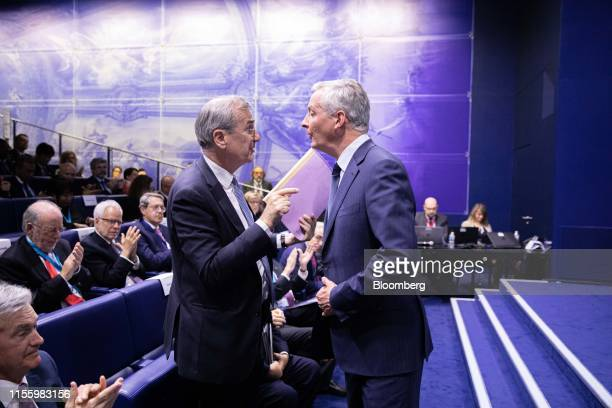 Francois Villeroy de Galhau governor of the Bank of France left speaks with Bruno Le Maire France's finance minister during the 75th anniversary of...