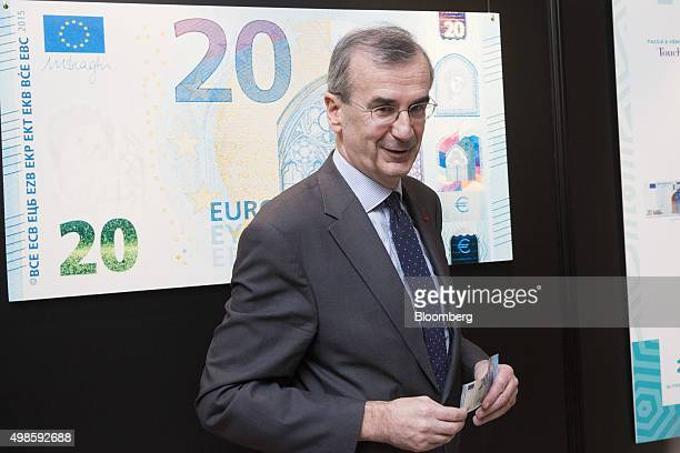 Francois Villeroy de Galhau governor of the Bank of France poses for a photograph with a new 20 euro currency bank note in Paris France on Tuesday...