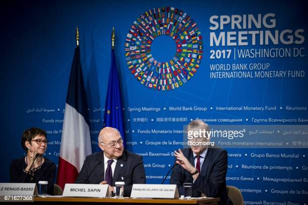 Francois Villeroy de Galhau governor of the Bank of France right speaks as Michel Sapin France's finance minister center and Odile RenaudBasso...
