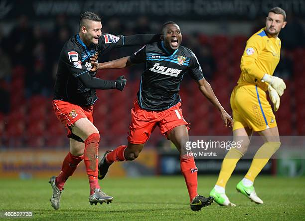 Francois Zoko of Stevenage celebrates with team-mate Marcus Haber after scoring their first goal during the FA Cup Third Round match between...