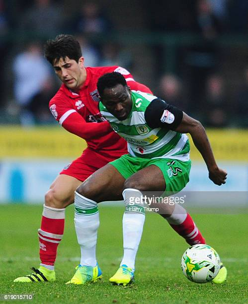 Francois Zoko of Yeovil Town is tackled by Zach Mills of Grimsby Town during the Sky Bet League Two match between Yeovil Town and Grimsby Town at...