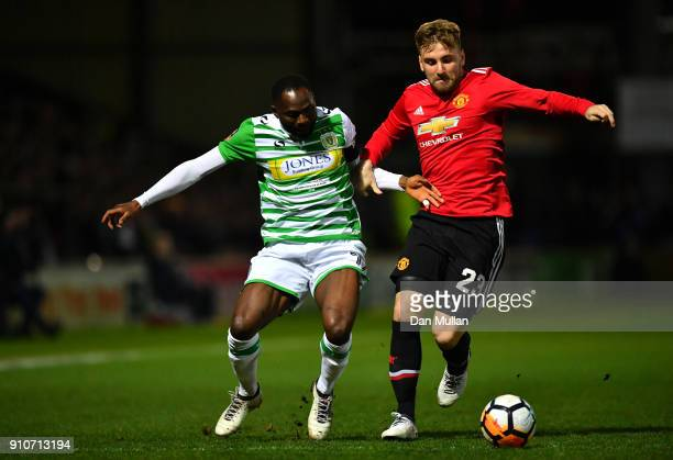 Francois Zoko of Yeovil Town tackles Luke Shaw of Manchester United during The Emirates FA Cup Fourth Round match between Yeovil Town and Manchester...