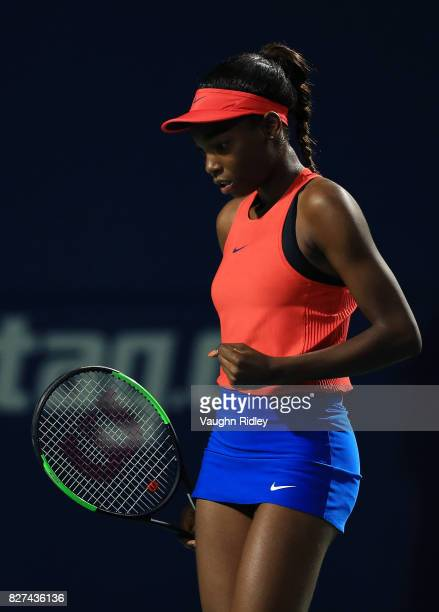 Francoise Abanda of Canada celebrates a point against Lucie Safarova of Czech Republic during Day 3 of the Rogers Cup at Aviva Centre on August 7...