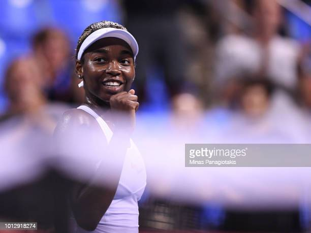 Francoise Abanda of Canada celebrates her victory over Kirsten Flipkens of Belgium during day two of the Rogers Cup at IGA Stadium on August 7 2018...