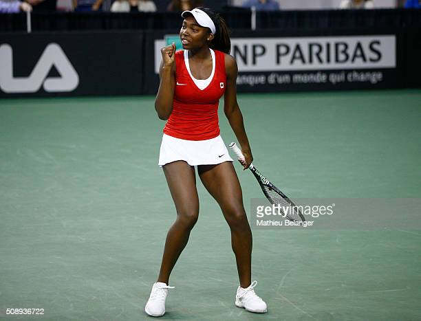 Francoise Abanda of Canada reacts after defeating Olga Govortsova of Belarus during their Fed Cup BNP Paribas match at Laval University in Quebec...