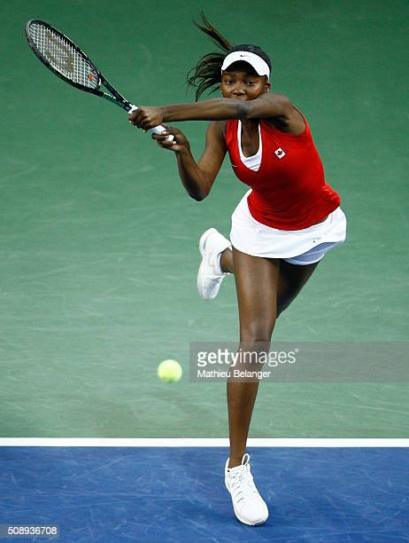 Francoise Abanda of Canada returns a shot to Olga Govortsova of Belarus during their Fed Cup BNP Paribas match at Laval University in Quebec City on...