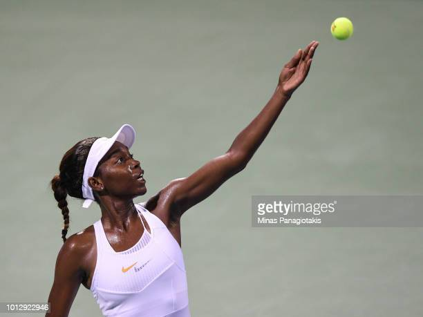 Francoise Abanda of Canada serves against Kirsten Flipkens of Belgium during day two of the Rogers Cup at IGA Stadium on August 7 2018 in Montreal...