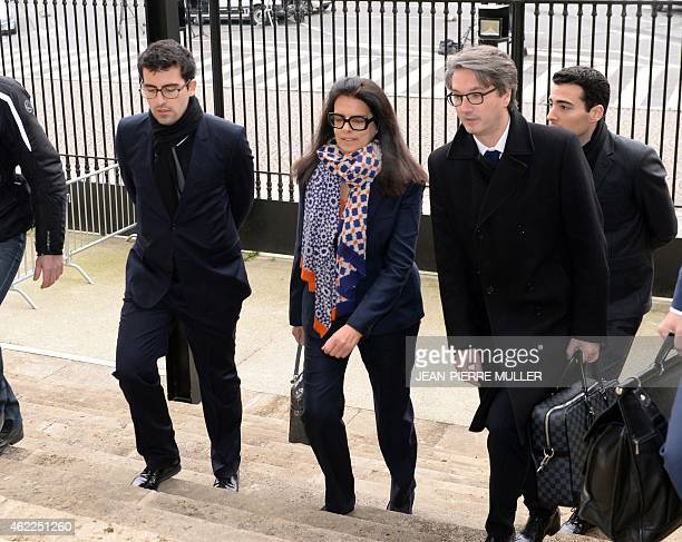 Francoise Bettencourt Meyers arrives with her lawyer Arnaud Dupin and her sons Nicolas and JeanVictor at the Court House in Bordeaux on January 26 to...