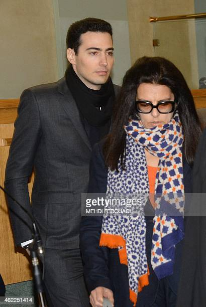 Francoise Bettencourt Meyers arrives with her son JeanVictor at the Court House in Bordeaux on January 26 to attend the first day of the trial of ten...