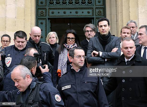 Francoise Bettencourt Meyers daughter of France's richest woman L'Oreal heiress Liliane Bettencourt flanked by her son JeanVictor lawyers of the...