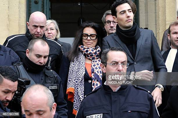 Francoise Bettencourt Meyers daughter of France's richest woman L'Oreal heiress Liliane Bettencourt flanked by her son JeanVictor and lawyers of the...