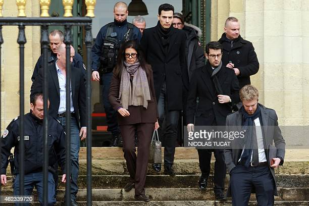 Francoise Bettencourt Meyers leaves the Court House in Bordeaux with her sons Nicolas and JeanVictor on January 27 during the second day of the trial...