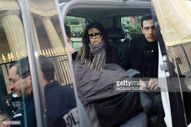 Francoise Bettencourt Meyers leaves the Court House in Bordeaux with her son JeanVictor on January 27 during the second day of the trial of ten...