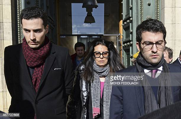 Francoise Bettencourt Meyers leaves with her sons Nicolas and JeanVictor the Bordeaux courthouse February 3 2015 for the 7th day of the trial of ten...