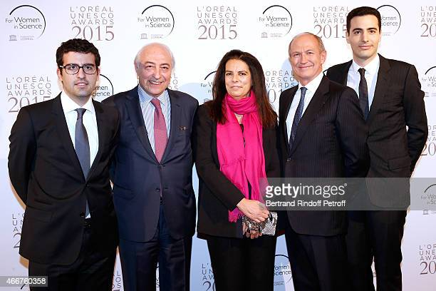 Francoise Bettencourt Meyers standing between her husband JeanPierre Meyers their sons Nicolas Meyers and JeanVictor Meyers and Chairman Chief...