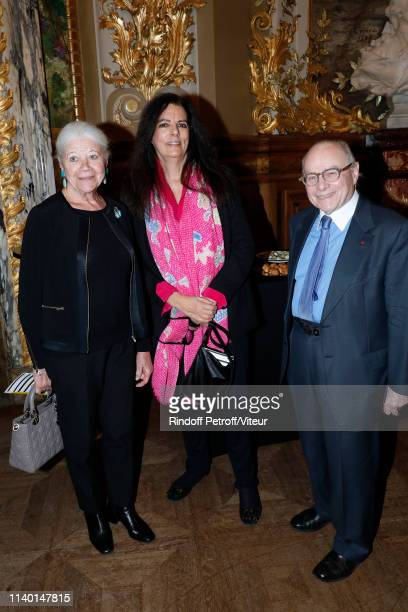 Francoise Bettencourt Meyers standing between Professor Alain Pompidou and his wife Nicole Pompidou attend the Fondation Bettencourt Schueller...