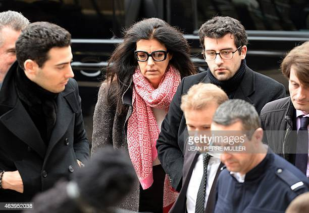 Francoise BettencourtMeyers daughter of France's richest woman Liliane Bettencourt and her sons Nicolas and JeanVictor arrive at the courthouse of...