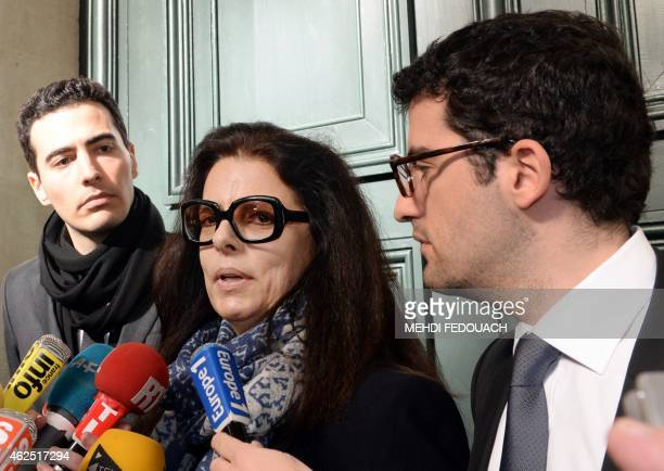 Francoise BettencourtMeyers the daughter of France's richest woman Liliane Bettencourt speaks to the press flanked by her sons JeanVictor and Nicolas...