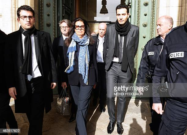 Francoise BettencourtMeyers the daughter of France's richest woman Liliane Bettencourt and her sons JeanVictor and Nicolas walk on January 30 2015 as...