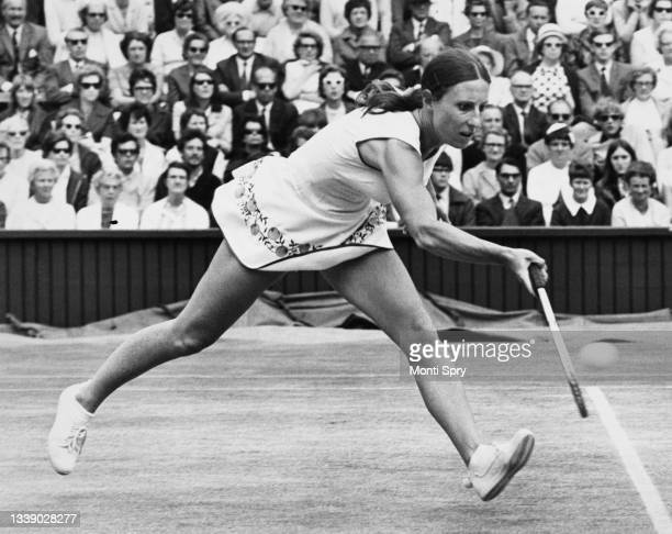 Francoise Durr of France reaches to play a forehand return to Billie Jean King of the United States during their Women's Singles Semi Final match at...