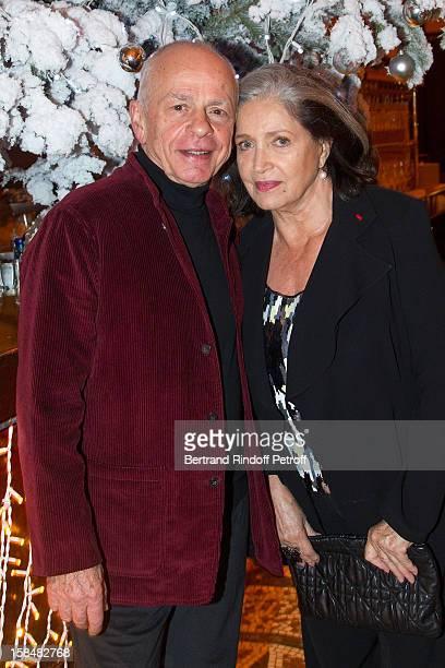 Francoise Fabian and Gerard Lartigau pose at restaurant Le Grand Colbert on December 17 2012 in Paris France