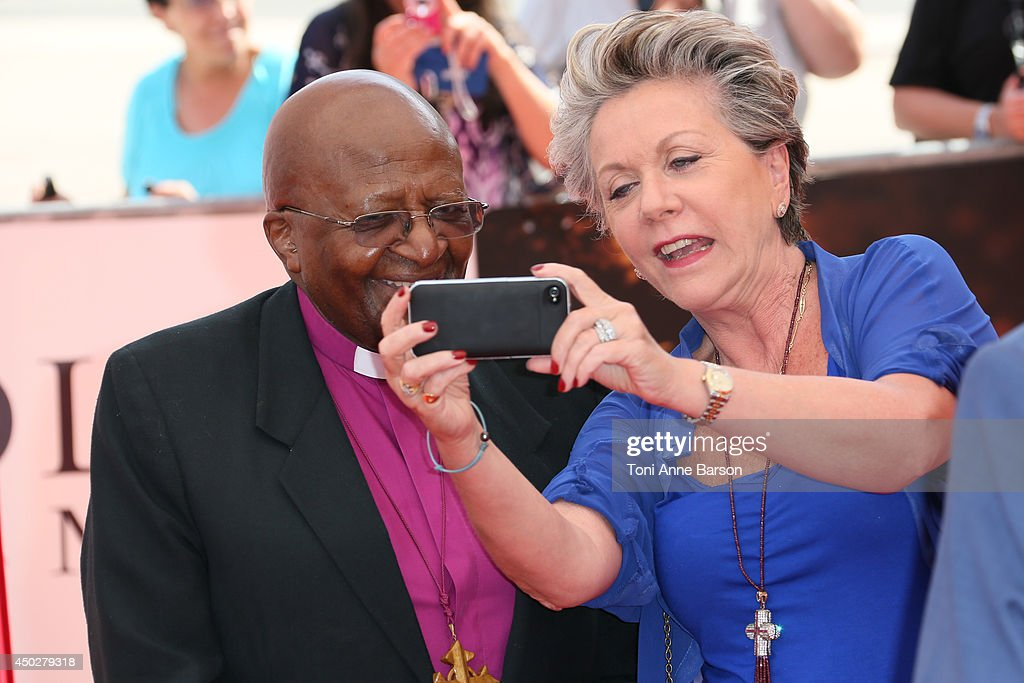 Francoise Laborde doing a 'selfie' with Desmond Tutu during arrivals for 'Children of the Light' world Premiere at the Grimaldi Forum on June 8, 2014 in Monte-Carlo, Monaco.