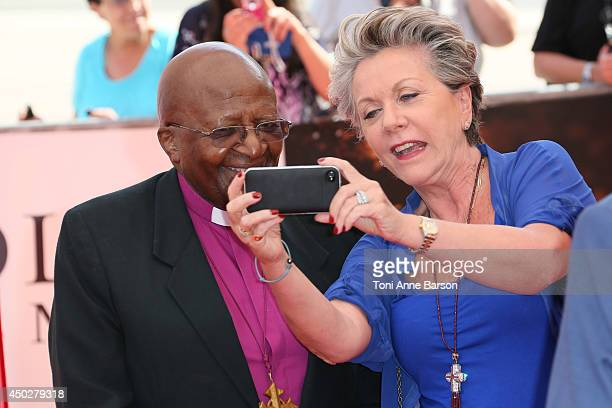 Francoise Laborde doing a 'selfie' with Desmond Tutu during arrivals for 'Children of the Light' world Premiere at the Grimaldi Forum on June 8 2014...