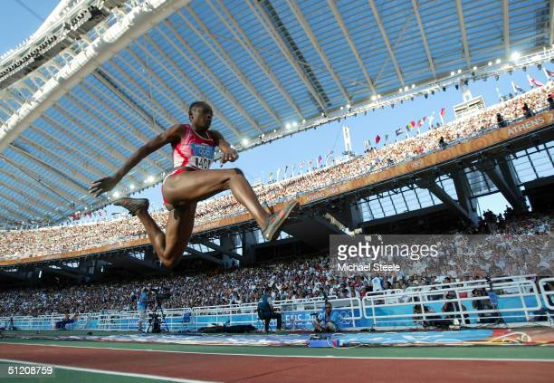 Francoise Mbango Etone of Cameroon competes in the women's triple jump final on August 23 2004 during the Athens 2004 Summer Olympic Games at the...