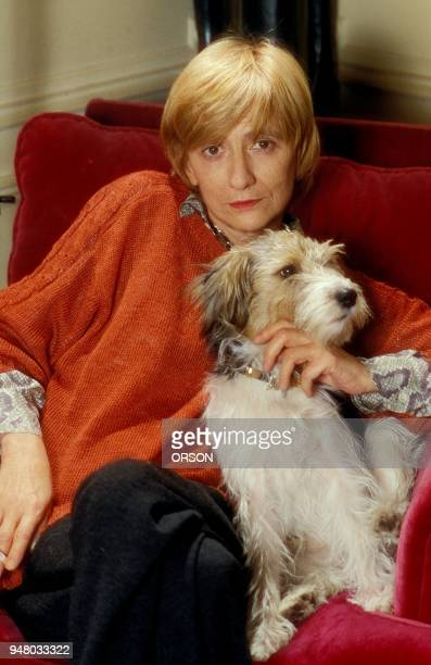 Francoise Sagan with her dog at home