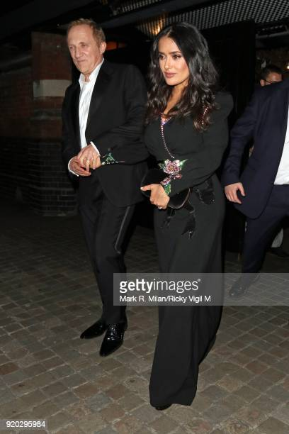 FrancoisHenri Pinaul and Salma Hayek seen at the Vogue and Tiffany Co party at Annabel's club after attending the EE British Academy Film Awards at...