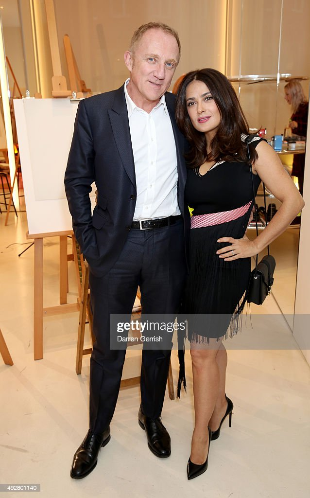 Francois-Henri Pinault and actress Salma Hayek attend the Christopher Kane Art Class 2015 at Christopher Kane Flagship 6-7 Mount Street on October 15, 2015 in London, England.