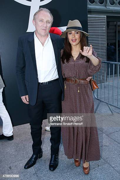 FrancoisHenri Pinault and Actress Salma Hayek attend the Saint Laurent Menswear Spring/Summer 2016 show as part of Paris Fashion Week on June 28 2015...